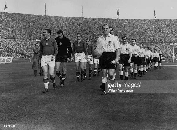 The English and Hungarian captains Ferenc Puskas and Billy Wright leading out their teams before a game at Wembley Stadium London