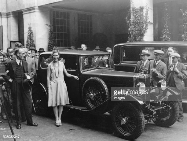 The English aviatrix Amy Johnson in front of a Morris car Grosvenor House Hotel / London 5th August 1930 Photograph
