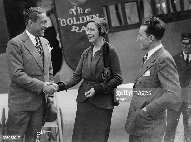The English aviatrix Amy Johnson welcomes the pilot Dieudonné Costes after his landing in Croydon With Maurice Bellonte 30th May 1931 Photograph