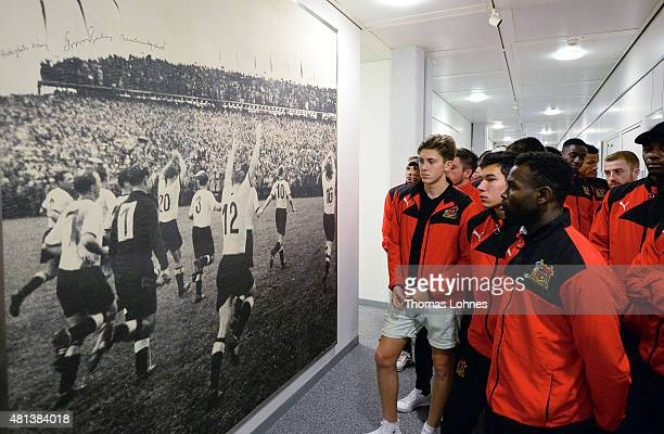 The English football team Sheffield FC from South Yorkshire look at a picture of the celebrating German team when the they won the World Cup Final of...