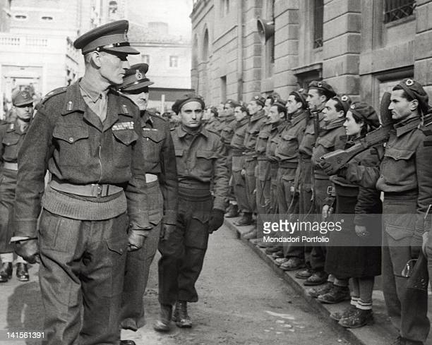 The English general Richard MacCreery, accompanied by the brigade commander Arrigo Boldrini, passes in review a partisan division in piazza...