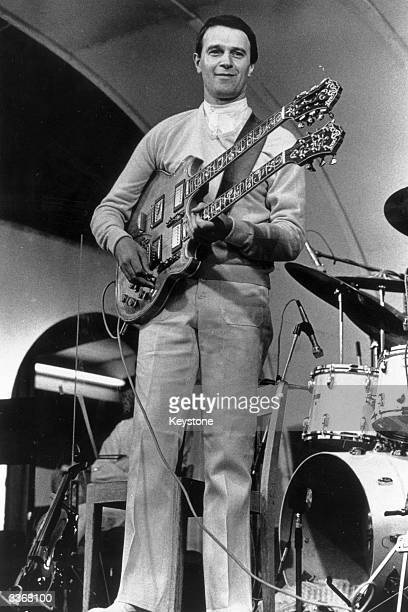 The English jazz-rock guitarist John McLaughlin playing a double-necked guitar in performance with his band The Mahavishnu Orchestra.