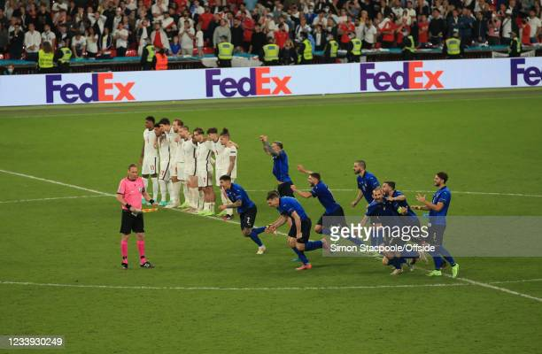 The English players stand still as the Italian players run to celebrate victory in the penalty shootout during the UEFA Euro 2020 Championship Final...