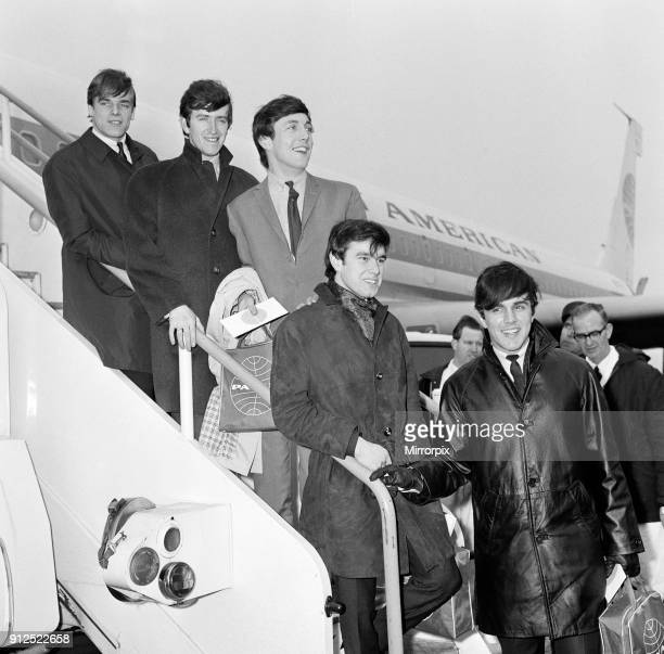 The English pop rock group Dave Clark Five at an airport leaving for America Members of the band are Lenny Davidson Rick Huxley Mike Smith Denis...