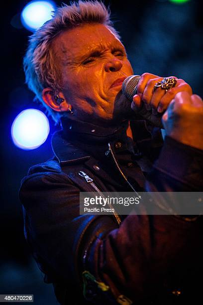 The English punk rock singer and song-writer Billy Idol pictured on stage as they perform in Piazza della Loggia Brescia.