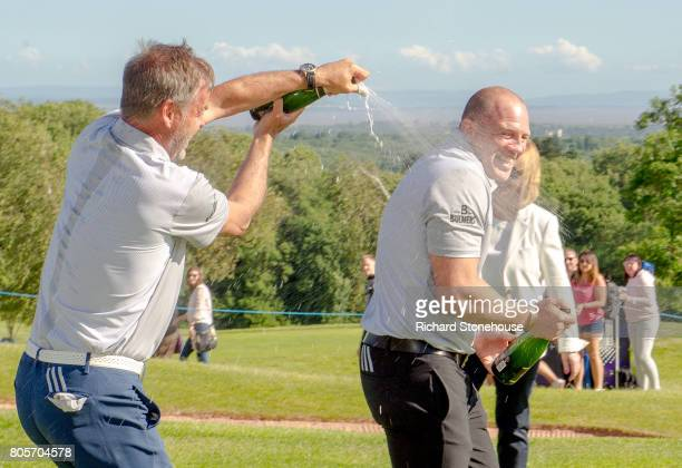 The English Team Peter Jones and Mike Tindall celebrate their win with a Champagne shower on day two of the Celebrity Cup at Celtic Manor Resort on...