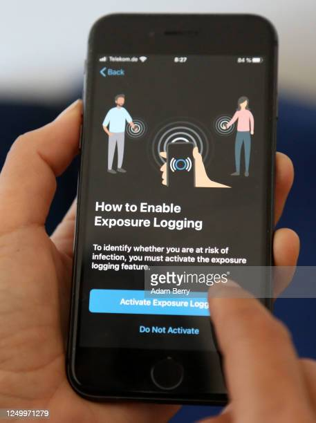 The English version of the German federal health ministry's Corona-Warn-App software is seen on an Apple iPhone in this photo illustration on the day...