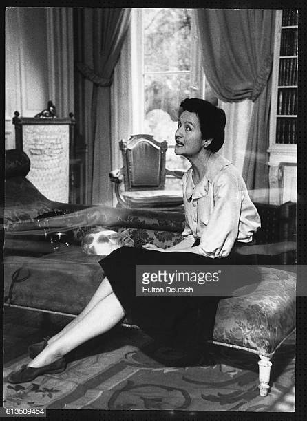The English writer Nancy Mitford pictured seated inside her Paris apartment, 1956. Her novels include The Pursuit of Love , Love in a Cold Climate...