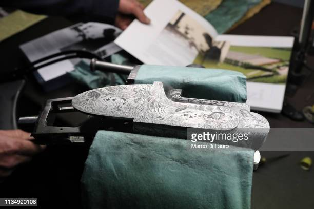 The engraved folder of a rifle produced by Giuseppe Zacchi Perazzi's master engraver is shown on April 4 2019 at the Perazzi Armi factory in...