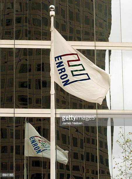 The Enron corporate flag waves in front of the companys headquarters January 23 2002 in Houston TX Federal prosecuters and the FBI are investigating...