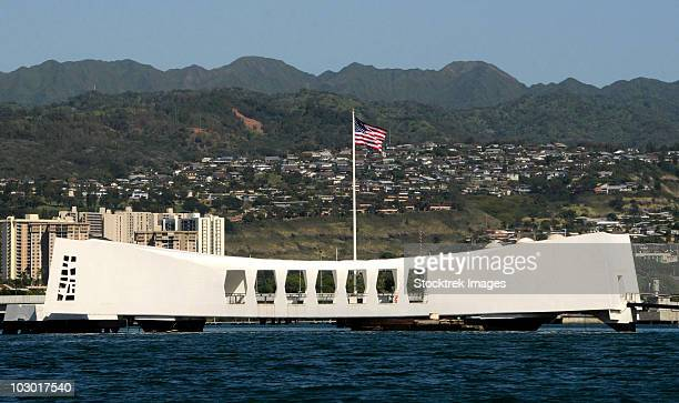 the ensign flies over the arizona memorial. - uss arizona stock photos and pictures