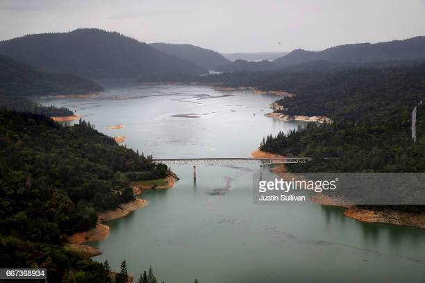 The Enterprise Bridge passes over a section of Lake Oroville on April 11, 2017 in Oroville, California. After record rainfall and snow in the...