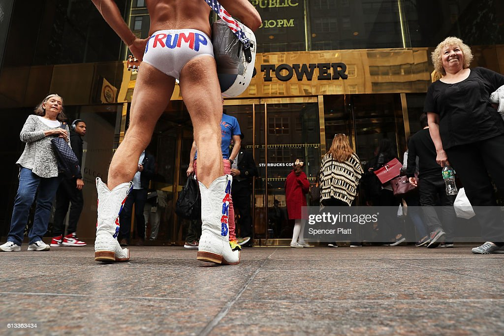 The entertainer Naked Cowboy stands in front of Trump Tower in Manhattan on October 8, 2016 in New York City. The Donald Trump campaign has faced numerous calls for him to step aside after a recording from 2005 revealed lewd comments Trump made about women.