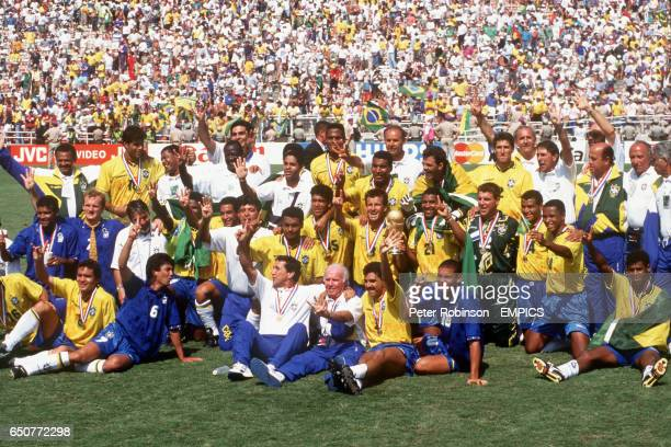 The entire Brazilian squad celebrate together with the trophy after winning in the final.