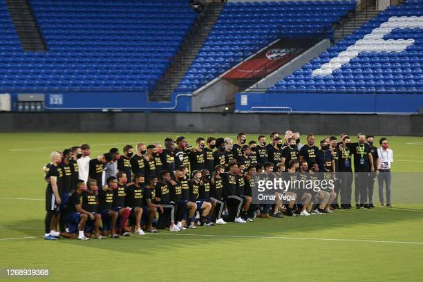 The entire FC Dallas team and staff pose after it was announced that the game was postponed between FC Dallas and Colorado Rapids as part of the...