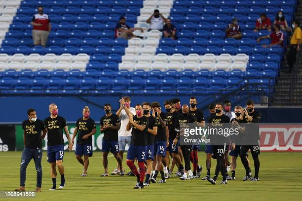 The entire FC Dallas team and staff wave fans after it was announced that the game was postponed between FC Dallas and Colorado Rapids as part of the...