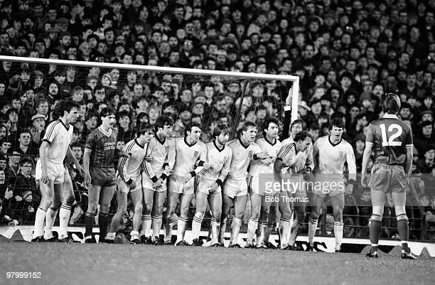 The entire West Ham United team line up in front of the Anfield Kop to form the defensive wall during their Football League Milk Cup 5th round match...