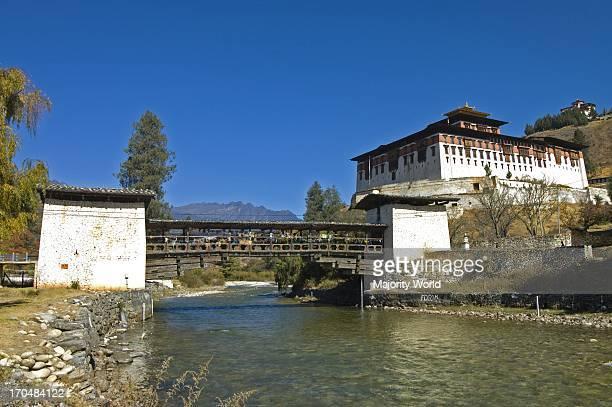 The entrance bridge of Rinpung Dzong a fortressmonastery overlooking the Paro valley in Paro Bhutan November 20 2007