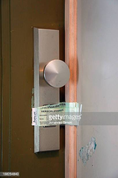 The entrance door sealed by the prosecution service to the apartment of former Bundesliga and FIFA referee Manfred Amerell on December 12 2012 in...