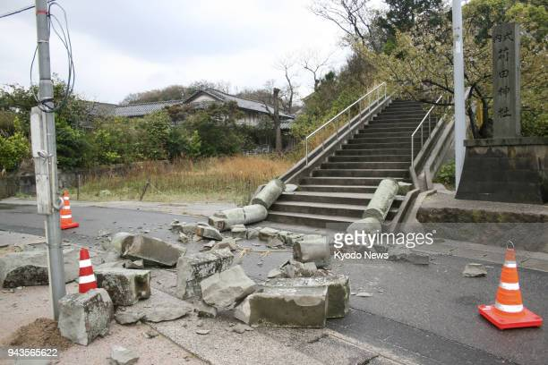 The entrance gate of a shrine is seen collapsed in Oda Shimane Prefecture after a magnitude 61 earthquake hit the western Japanese prefecture on the...