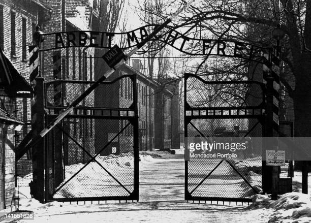 The entrance gate to Auschwitz concentration camp. Auschwitz , 1940s