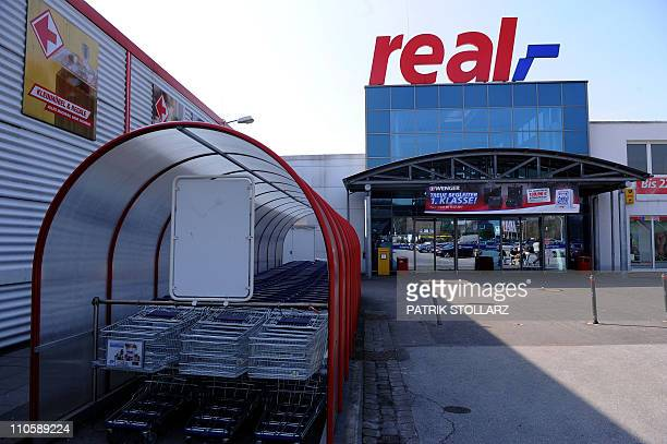 The entrance of a real warehouse a retail chain of German retail giant Metro Group can be seen on shopping trolleys on March 22 2011 in Ratingen...