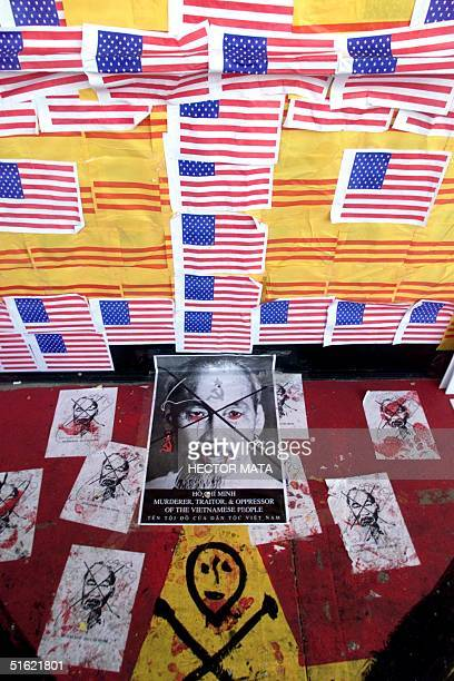 The entrance of a video shop is plastered with US and Vietnamese flags and portraits of the late communist leader Ho Chi Minh 27 February in Little...