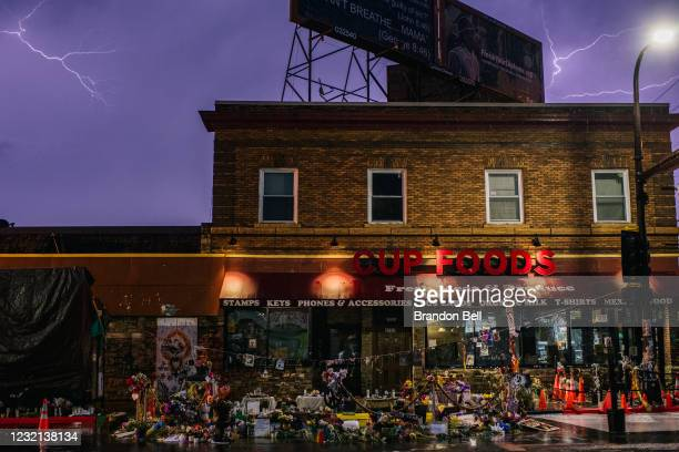 The entrance of Cup Foods, the site where George Floyd died, is seen in a thunderstorm from the intersection of 38th Street and Chicago Avenue on...