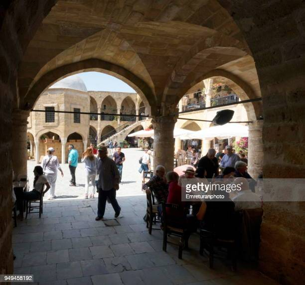 "the entrance of historic ""buyukhan"" in nicosia. - emreturanphoto stock pictures, royalty-free photos & images"