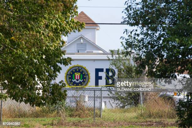 The entrance of the First Baptist Church in Sutherland Springs Texas is seen following a mass shooting that left 26 people dead A gunman wearing all...