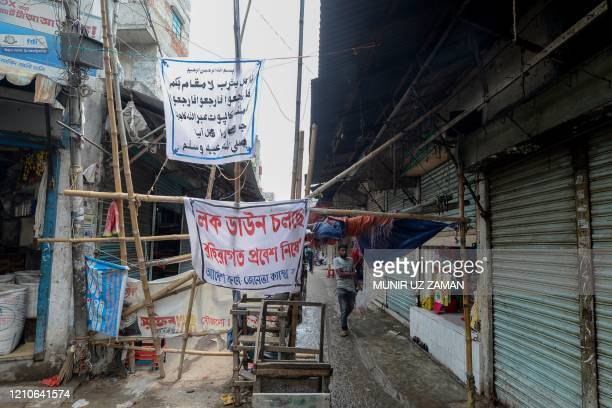 The entrance of the Geneva camp where stranded Bihari residents live is blocked during a government-imposed nationwide lockdown as a preventive...