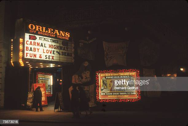 The entrance of the Orleans Off Broadway Theatre an adult movie theater in the Times Square area shows the marquee and posters advertising its...