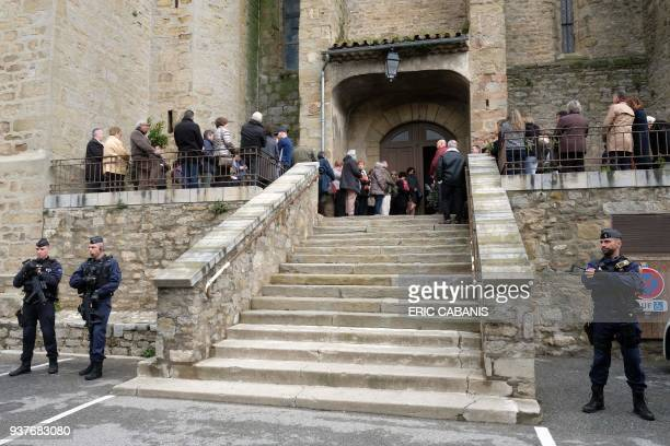 The entrance of the Saint Etienne Church in Trebes in southwest France is pictured during a service of remembrance on March 25 two days after a man...