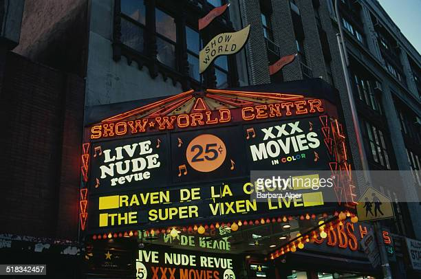 The entrance of the Show World Center strip club, 8th Avenue, New York City, USA, 10th January 1984.