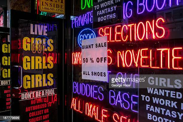 The entrance to a live girl strip club on 8th Avenue is viewed on October 24 2013 in New York City With a full schedule of conventions and major...