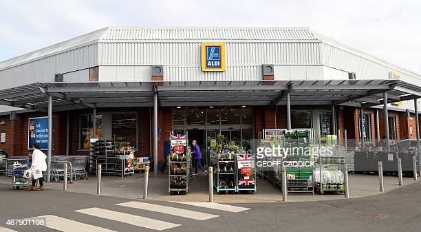 The entrance to an Aldi supermarket is seen in Worcester central England on March 23 2015 The struggling middle class is at the heart of the campaign...