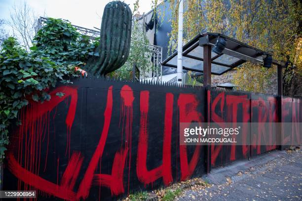 "The entrance to Berlin's legendary KitKat Club is decorated with a graffito reading ""Clubs are dying"", on December 2, 2020. - The club, closed for..."