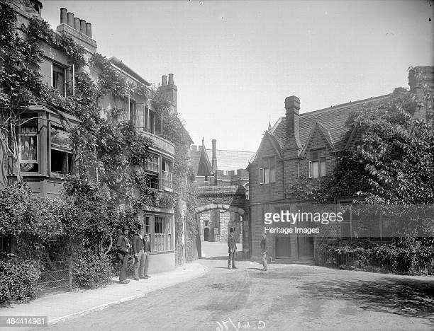 The entrance to Brewhouse Yard Eton College Eton Berkshire c1860c1922 with a group of gentlemen in the foreground