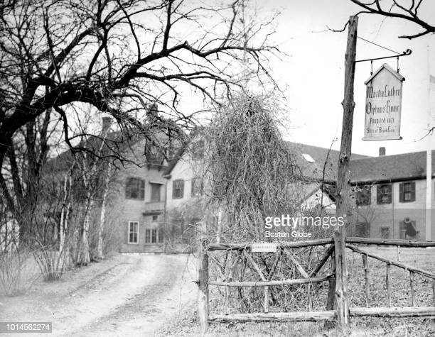 The entrance to Brook Farm in the West Roxbury neighborhood of Boston is pictured circa December 1932.