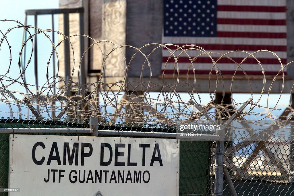 The entrance to Camp Delta where detainees from the U.S. war in Afghanistan live is shown April 7, 2004 in Guantanamo Bay, Cuba. On April 20, the U.S. Supreme Court is expected to consider whether the detainees can ask U.S. courts to review their cases. Approximately 600 prisoners from the U.S. war in Afghanistan remain in detention.