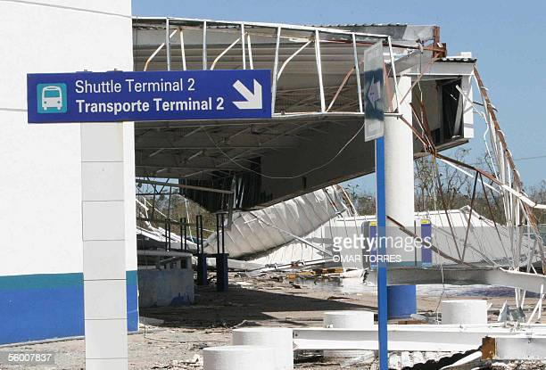 The entrance to Cancun's airport shuttle Terminal 2 remains severely damaged 25 October 2005 in the aftermath of the devastating passage of Hurricane...