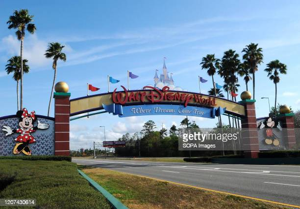 The entrance to Disney World is deserted on the first day of closure as theme parks in the Orlando area suspend operations for two weeks in an effort...