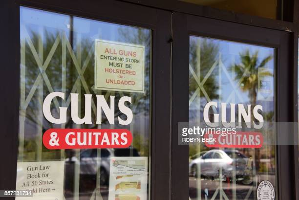 The entrance to Guns Guitars store is seen in Mesquite Nevada October 3 2017 Stephen Paddock who had purchased fire arms at Guns Guitars killed 59...