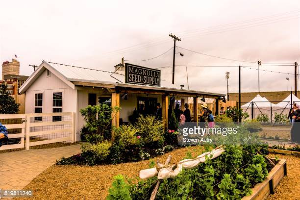 waco, tx, usa  march 18, 2017: the entrance to magnolia seed and supply overlooking plants in the garden area of magnolia silos. - waco stock pictures, royalty-free photos & images