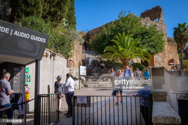 the entrance to the ancient greek theatre in the city of taormina, sicily, italy - finn bjurvoll stock pictures, royalty-free photos & images