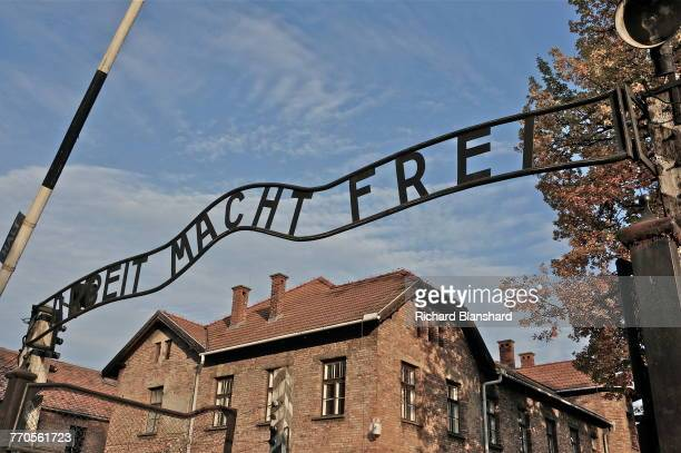 The entrance to the Auschwitz I German Nazi concentration and extermination camp, with the motto 'Arbeit macht frei' over the gateway, southern...