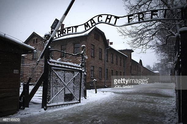 The entrance to the former Nazi concentration camp AuschwitzBirkenau with the lettering 'Arbeit macht frei' in Oswiecim Poland is pictured on January...