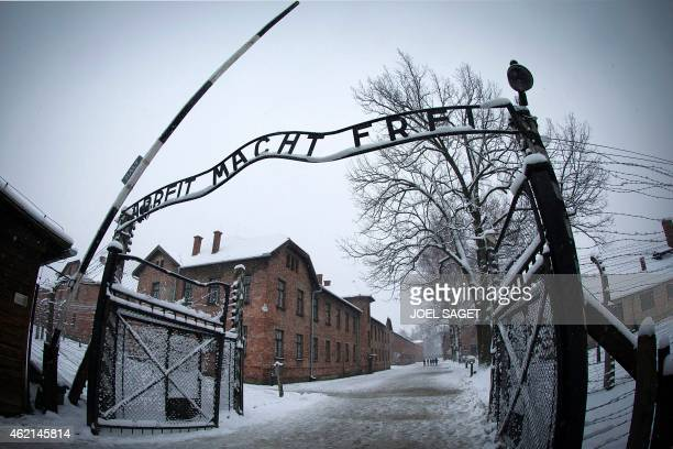 The entrance to the former Nazi concentration camp AuschwitzBirkenau with the lettering 'Arbeit macht frei' is pictured in Oswiecim Poland on January...