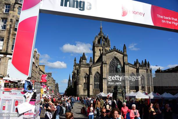 The entrance to the Fringe area on the Royal Mile during the Edinburgh Festival Fringe with St Giles' Cathedral dominating the scene on August 17...