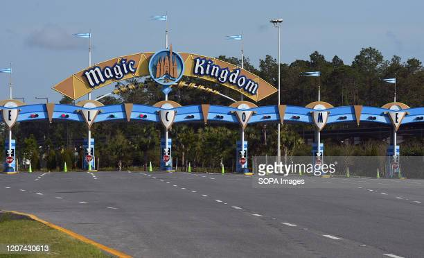 The entrance to the Magic Kingdom at Disney World is seen on the first day of closure as theme parks in the Orlando area suspend operations for two...